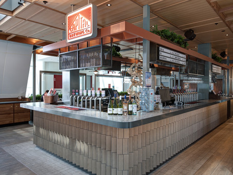 Ash Grey brick tiles add warmth and tactility to the Capital Brewing Company Tap Room