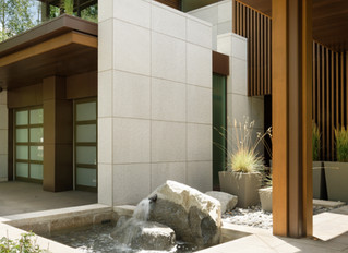Golden Dune Granite and New Pearl Limestone bring a contemporary mountain masterpiece to life