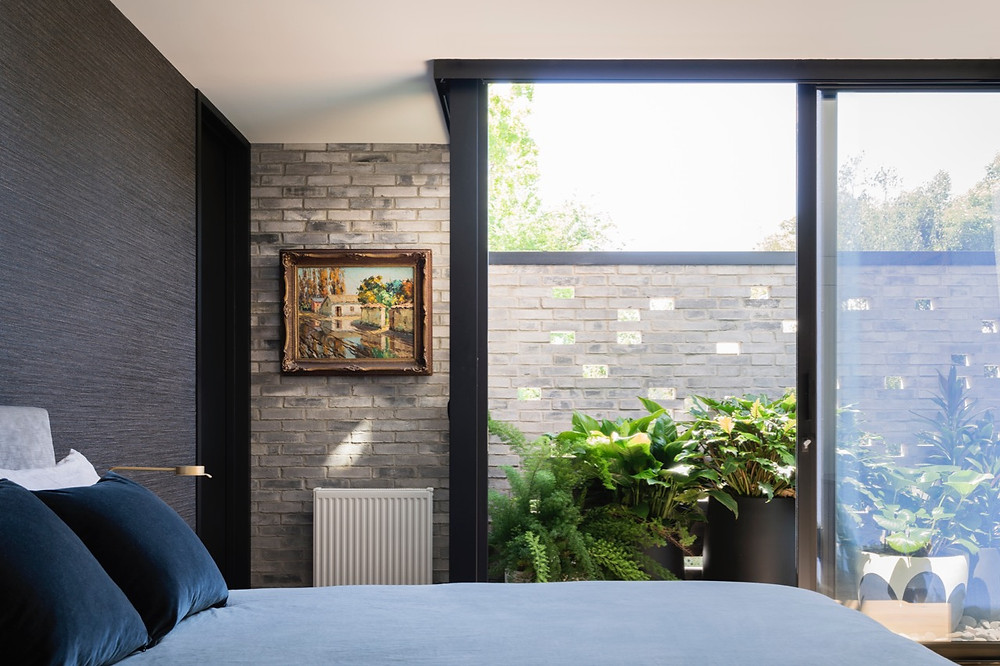 Petersen D91 bricks work both inside and outside this bedroom