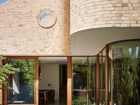 Krause Cream bricks joyfully celebrate the art deco curves at Waterfall House