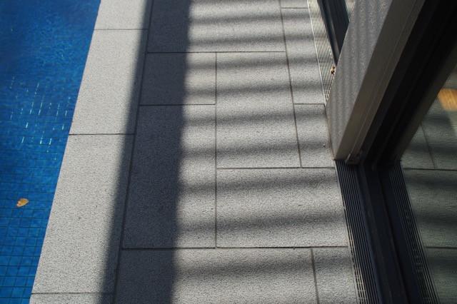 Silver granite poolside paving