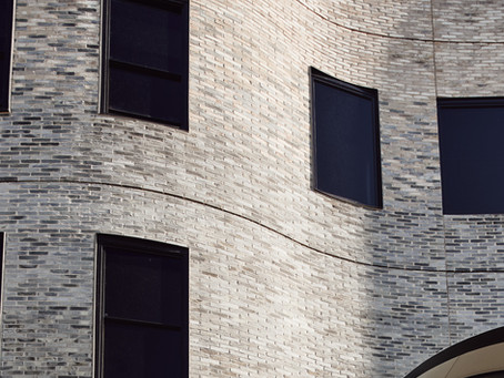 A curved veil of Petersen bricks reflects the innovation in MLC's new Nicholas Learning Centre