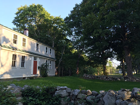 Front lawn and original stone walls at the Chamberlain House