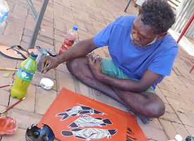 indigenous art, artist on site, painting