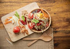som-tam-thai-thai-papaya-salad-wooden-background_1150-14653.jpg