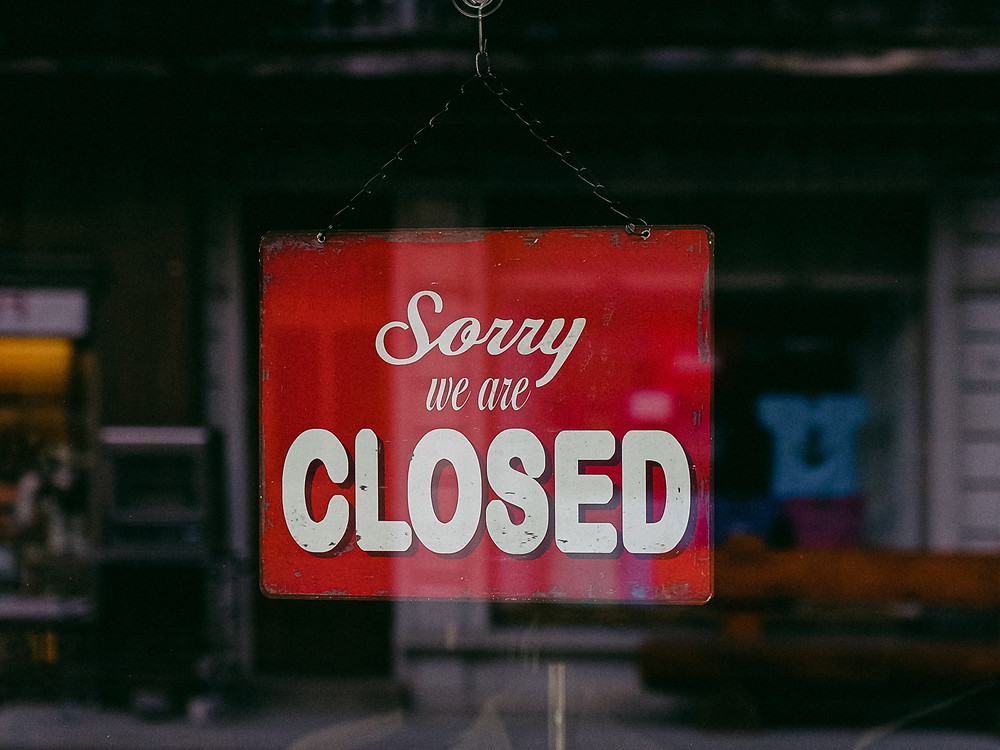 """Shop sign that says, """"sorry, we are closed."""""""