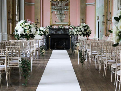 White wedding flowers for an aisle
