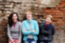 Outdoor portrait of three women standing