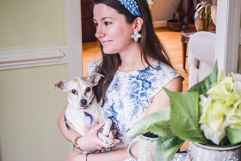 woman-holding-dog-pottery-jewelry-gold-flower-jewelry-woman-wearing-headband-pottery-vase-with-flowers-rat-terrier-dog.jpg