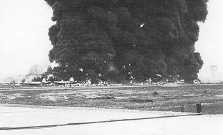 1024px-Burning_Aircraft_on_ramp_at_Bien_