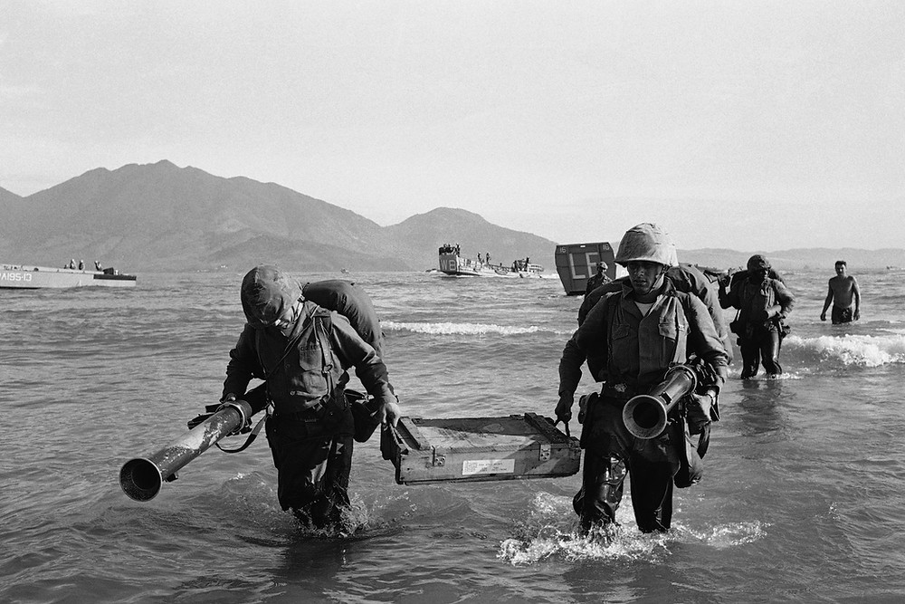 Members of the 9th U.S. Marine Expeditionary Force go ashore at Danang, South Vietnam, on March 8, 1965. Assigned to beef up defense of an air base, they were the first U.S. combat troops deployed in the Vietnam War | Photo Credit: AP