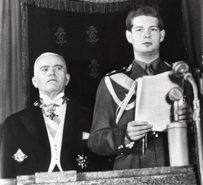 King Michael I (right), standing next to communist leader Petru Groza