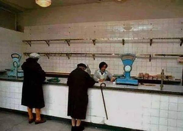 """Empty shelves in a Romanian grocery store (""""alimentara"""") during the 1980's austerity regime."""