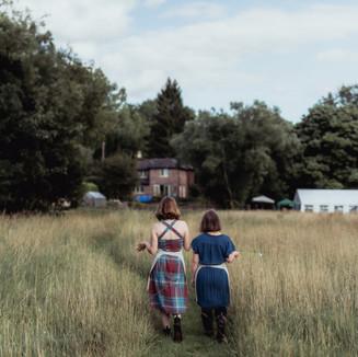 Both walking away in field landscape.jpg