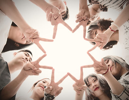 group-of-people-forming-star-using-their