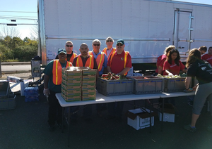 Sugaright Health & Safety and H R team members volunteering at a community food distribution event.