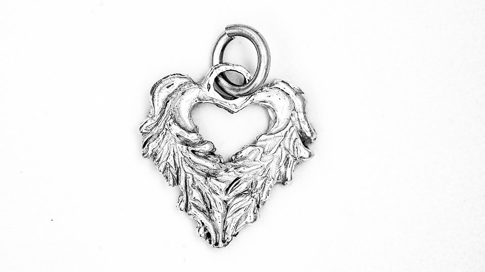 Heavy weight winged heart pendant