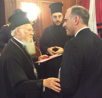 Michael Haldas presents Sacramental Living as a gift to Eucmencial Patriarch Bartholomew at the Patr