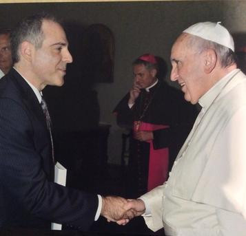 Michael Haldas presents Sacramental Living as a gift to Pope Francis at the Vatican