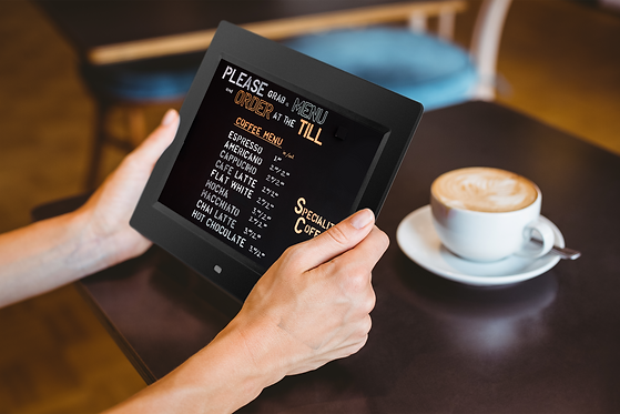 a-woman-using-tablet-computer-at-the-cafe-PPB32NU.png