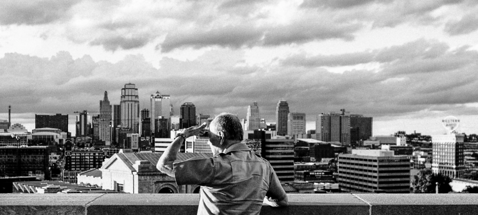 KC Skyline Image with Person.png
