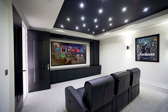 Custom Home Theater design by Connected Home Inc. in Leland NC offering and installing Sony projectors, projector screens, and Atmos enabled surrond sound systems in Wilmington NC, Figure Eight Island NC, Oak Island NC, Southport NC and Saint James NC.