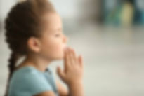 97449229-cute-little-girl-praying-at-hom
