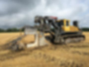 agricultural farm drainage plow in field