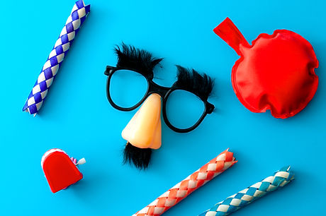 Comical prank, April fools practical joke and goofy disguise concept farting bag, chattering teeth,