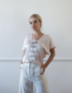 CONNI KAMINSKI SUMMER 2019 BRUSSELS BEGIUM FASHION DESIGNER ROSE SILK TOP WHITE LINNEN PANTS