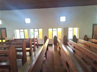 Timber pews inside Methodist Church, Uma