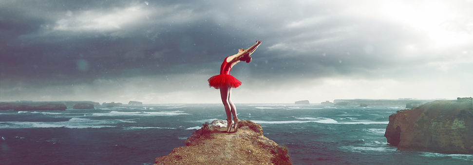 Ballet Dancer in front of a stormy sea l