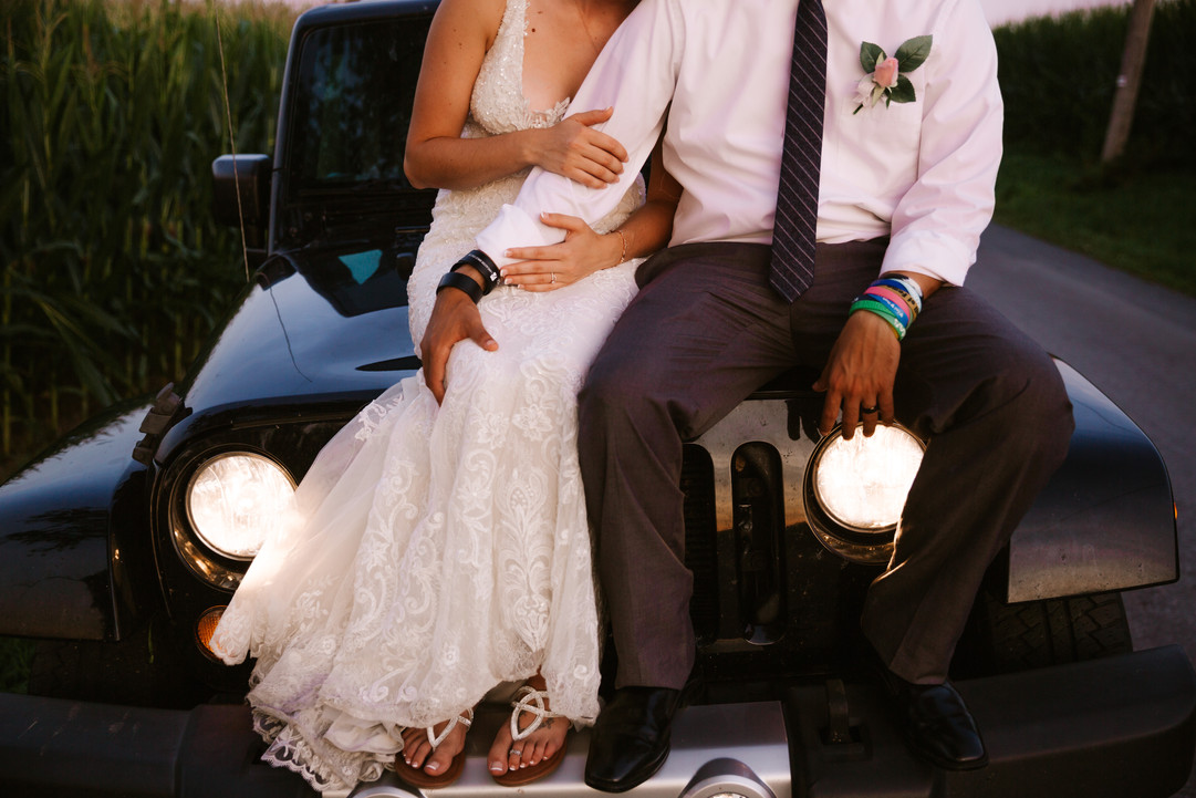 Jeep and bride and groom