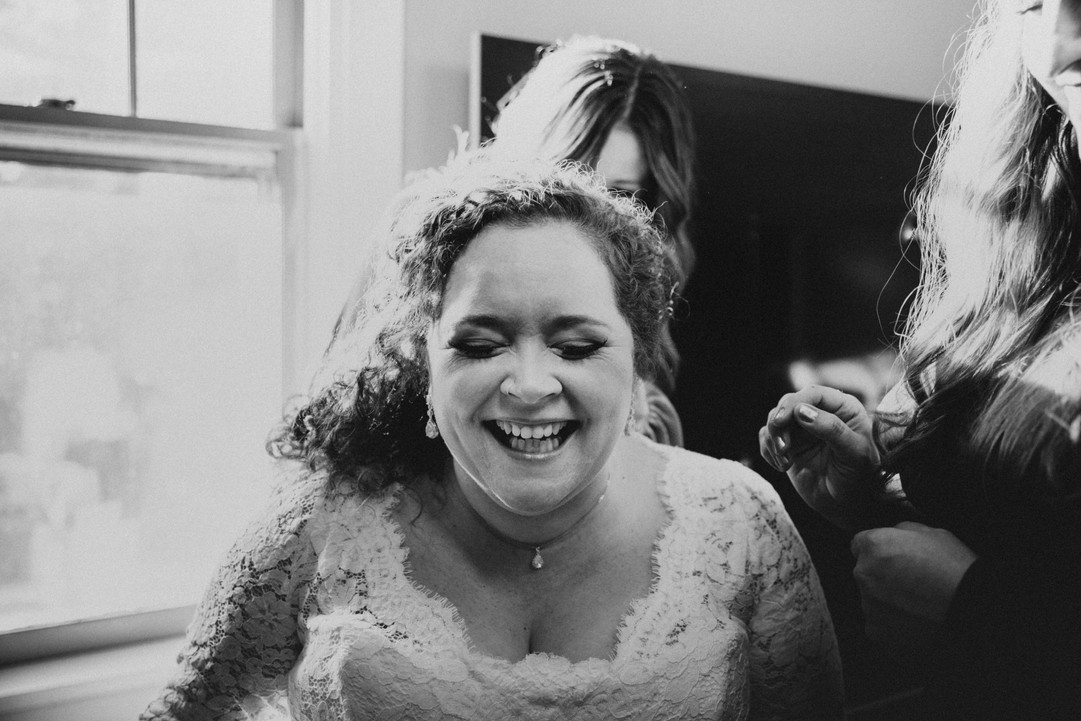 Candid bride laughing