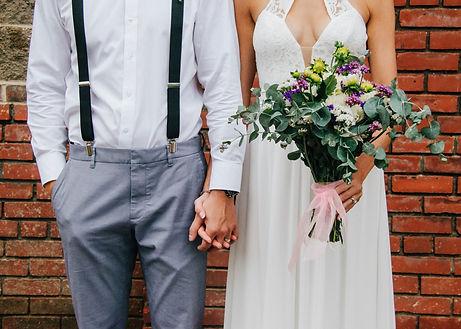 groom-bride-holding-hands-scaled.jpg