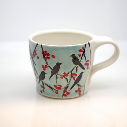 right hand view, a flock of ravens with red berries, blue sky, mug
