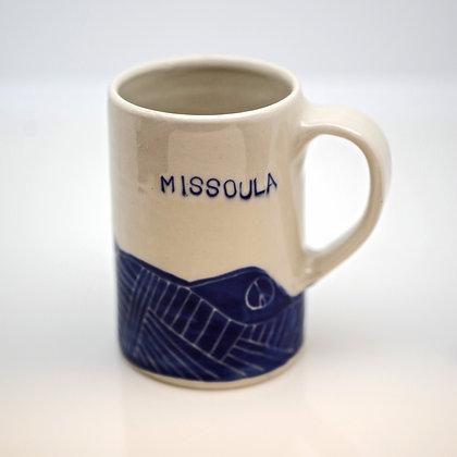 front view, blue stylized mountains, white mug, Missoula text