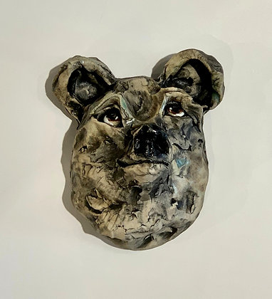 Clay bear portrait with black markings