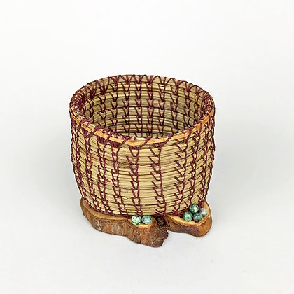 Small pine needle basket with burgundy threads and green beads
