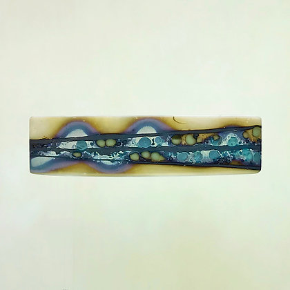Glass barrette, ivory, brown, teal and sage rolling design