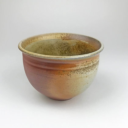 Beautiful earthtone wood fired bowl in rust and tans by Larry Phan.