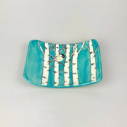 Small rectangular clay dish with small chickadee and aspen trees in aqua background