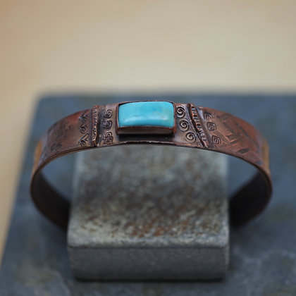 hammered copper cuff with turquoise cabachon