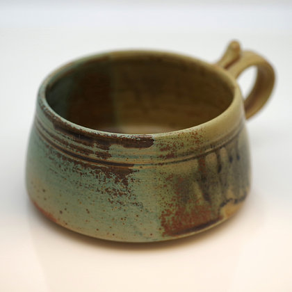 front view, brown and green soup mug