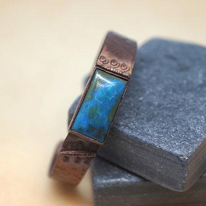 rectangular blue Apatite stone set in textured copper cuff