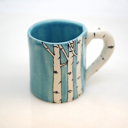 right hand view, light blue with white aspen design, small mug