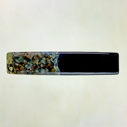 Glass barrette, solid black half contrasting patterned section of crushed glass in teal, green, amber shades