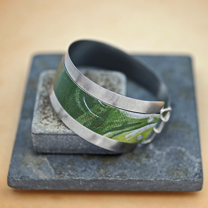Contemporary cuff from recycled green litho tin