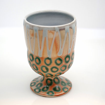 green and tan clay goblet  with geometric design