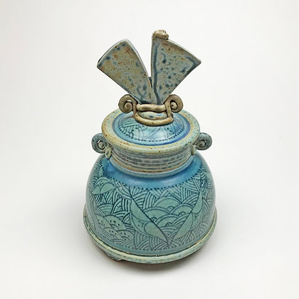 Blue art deco and asian flair in this lidded jar by Donna and Jeff Tousley.